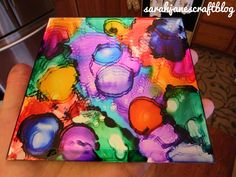 Alcohol Ink on a mirrored candle plate with a fire application diy craft tutorial.