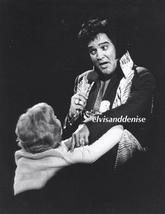 A fan getting up close Love his face in the first... - Elvis never left