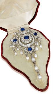 A stomacher, pre 1889, previously owned by the 6th Duke of Portland. It was auctioned by Christie's in 2010. The current owner remains anonymous. A stomacher was type of jewelry that was pinned to the fabric stomacher of an 18th century gown.