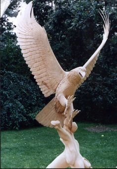 Life size Bald Eagle in Flight carved in one piece from a lime tree by woodcarver Ian G Brennan <><> More info:
