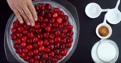 She Pours Batter Over A Baking Dish Filled With Fresh Cherries1
