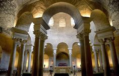 Santa Costanza, Rome.  The plan is based on two concentric rings. The void is surmounted by a ribbed brick saucer dome.  On entering the church, you see the Baroque altar straight ahead beneath the dome.  The walls would originally have been covered with mosaics and marble reverting. Only a small portion of the mosaics survive.