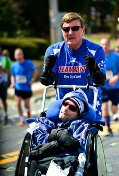 Team Hoyt: Dick Hoyt (72) & his son Rick (51), who has cerebral palsy, have raced in 31 Boston Marathons.  I went to the same college as Rick and would see his father bring him around campus.