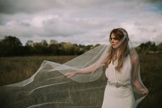 A custom bridal veil from the by KYNA Collection. Jennifer wears a Jewelled Cap veil with a detailed crystal sides and a crystal beaded drape across the back. Full range of Bridal headwear, veils and accessories available online. Shot in a bog in Ireland Wedding Hair Accessories, Veils, Crystal Beads, Headpiece, Vintage Inspired, Wedding Hairstyles, Ireland, Ready To Wear, Range