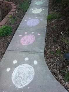 Paw prints on the front walk leading up to the front door with sidewalk chalk for my kids jungle theme birthday party. Everyone loved it!!