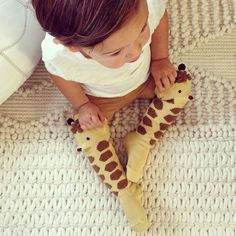 OK, not nursery design but @caitdevss, I think you need to own these for your little guy!!! giraffe socks