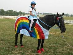 CKRH Blue with Dorothy and Rainbow blanket. Horse costume by Shirley Gentry