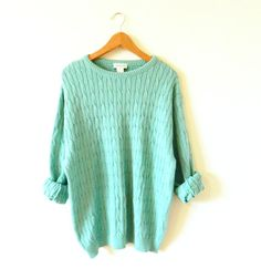 Soft and cozy vintage sweater in a yummy spearmint green! Cable knit, with a…
