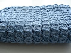 From Ravelry.com: Pretty slip stitch blanket, free pattern, 3 sizes. Looks like twisted cable.