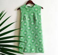 A personal favorite from my Etsy shop https://www.etsy.com/listing/271625411/60s-spring-mini-dress-green-floral
