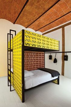 Splashy bunk beds made from yellow lattice brick outfit this stylish hostel in central Mexico City designed by architect Abraham Cherem. Photo by Undine Pröhl. This originally appeared in A Stylish Budget Hostel in Mexico City. Hostels, Hemnes, Suites, Prefab Homes, How To Make Bed, Interiores Design, Bunk Beds, Small Spaces, Furniture Design