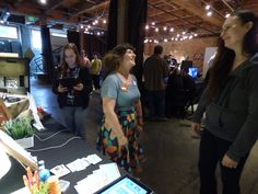 The tablets are off in the rest of the expo as people attempt to answer challenges. Expo 2015, First Time, Seattle, Rest, Challenges, Friends, People, Fun, Amigos