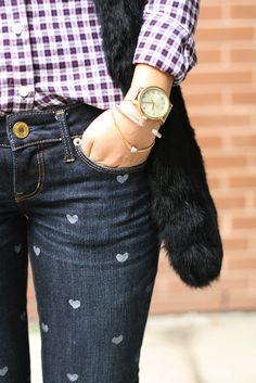 That's actually pretty cute. I imagine it would pretty easy to do yourself. Heart-print jeans.