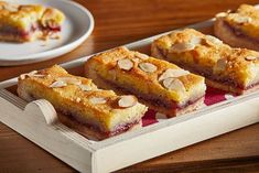 Bakewell, a classic British almond-raspberry tart becomes gluten-free bars We've adapted this dessert to be gluten-free, thanks to a crisp almond meal crust. Gluten Free Bars, Gluten Free Treats, Gluten Free Recipes, Gf Recipes, Dairy Free, Tart Recipes, Recipies, 16 Bars, Bakewell Tart