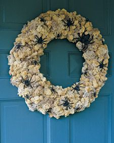 No one will dare darken your doorstep while this aging, spider-infested wreath hangs over it.    The secret is reindeer moss, actually a lichen.    1. Hot-glue handfuls of moss to a Styrofoam wreath form until covered.    2. Apply a thin coat of craft glue to plastic spiders (available at Halloween stores); sprinkle with black glitter. Hot-glue spiders onto wreath.