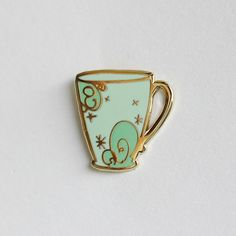 Dont you love a good cuppa? This pin is 1 tall with minty hard enamel and a gold finish for some extra bling. Comes with a rubber clutch.