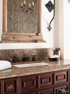 Honed green marble creates bathroom countertops with an old-world outlook. Green marble boasts significant veins in various shades that work well with weathered patinas and antique accessories. Its deep tones complement metal accents, such as black wrought-iron sconces, copper chandeliers, and bronze faucets./