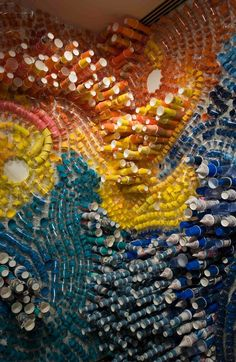 Lisa Hoke creates colorful wall collages out of an assortment of disposable items such as paper and plastic cups.