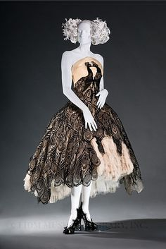 """Every feather was plucked from the cape of a fallen king"" All time best dress"