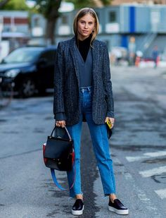 Style Notes: Tine Andrea of The Fashioneaters was one of the many Copenhagen girls who we saw in the old-school combination of a blazer and jeans. A posh bag always helps up the ante.
