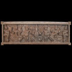 This beautiful #wooden wall panel is alive with many figures!  The main three deities are the seated forms of #Ganesh, #Lakshmi and #Saraswati.  Saraswati is seated to #Ganesha's left and is playing her customary guitar-like instrument called a #veena.  Lakshmi is seated to Ganesha's right and holds two #lotus #flowers, symbols of fertility and purity.  Between the three gods are two, small dwarf attendants of Lord Ganesh called #Gana. http://www.tagoresculpture.com/product.php?cat=1&pro=31