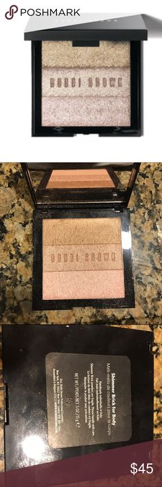 Bobbi Brown - shimmer brick for body Shimmer Brick for Body lets you create head-to-toe glamour. The lightweight, silky powder can be used on the arms, legs, neck, or anywhere you want to glow. The deluxe, oversized compact features three shimmering bars of color. For Anyone who wants to give her skin a flattering glow. The Shimmer Brick for Body is inspired by Bobbi's iconic and popular Shimmer Brick. Brand New - box not included. Bobbi Brown Makeup