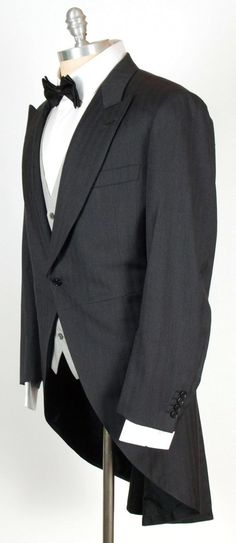 Flaunt some classic elegance, thin this charcoal Brioni tailcoat suit!  |  Shop Suits: http://www.frieschskys.com/suits  |  #frieschskys #mensfashion #fashion #mensstyle #style #moda #menswear #dapper #stylish #MadeInItaly #Italy #couture #highfashion #designer #shopping