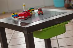 Ikea LACK Lego hack.  Total $30 1 LACK side table from IKEA ($7.99)  1 TROFAST bin from IKEA ($3.99)  1 LEGO play plate from Target ($12.99)  Loctite Stick N Seal (you can also use Earthquake Putty) ($3.29)   While you're at IKEA, you need to go to the Returns desk and ask if you can purchase (or have) a set of the TROFAST rails. They are plastic. At my IKEA they gave them to me.  Total $30