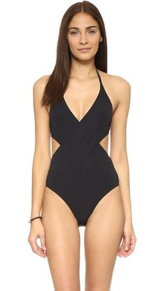 Crossover panels form the barely-there bodice on this one-piece Tory Burch swimsuit. Hook-and-eye closure and tie straps. Lined.