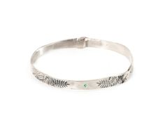 e.g.etal - Leaves bangle by Claire Taylor. Sterling silver, oxidised sterling silver, emeralds.