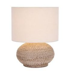 """Add a nautical touch to your décor with the Normandy Coil Table Lamp. Twisting cream rope is elegantly coiled into a richly textured base, topped with a classic shade for timeless appeal.    Product: Table lamp Construction Material: Natural woven material Color: Cream  Dimensions: 16"""" H x 10"""" Diameter"""