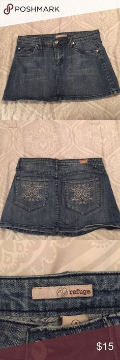 Never worn jean skirt by refuge! Size 9. Never worn jean/denim skirt by refuge. Size 9. Great condition with pretty back pockets! refuge Skirts Mini