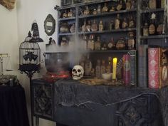 Witch's potion room - fire under pot is two grapevine wreaths and orange flickering lights