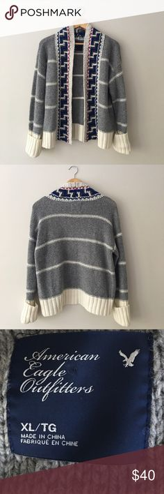 AEO Open Cardigan NWT. Geometric designed open cardigan by AEO. Gray and winter white window pane design with geometric border. Ribbed cuffs that roll. Size XL American Eagle Outfitters Sweaters Cardigans