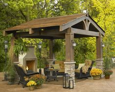"""The Lodge"" -- This 10'x10 pergola has a natural, classic look with its split timber and curved beams. It's a beautiful, substantial way to add an additional outdoor room to the back yard. I love the stacked stone and the craftsman style lighting."