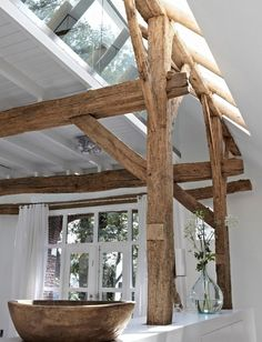 Exposed wooden beams are so chic on clean white