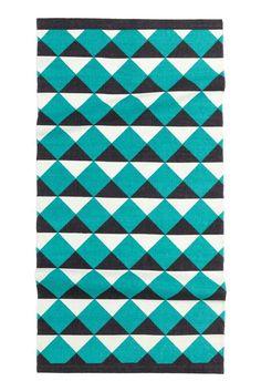 Tapis à motif imprimé: Tapis en coton avec motif imprimé.