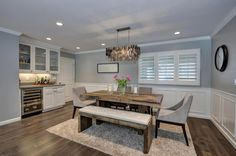 Dining room with beverage center and wainscoting