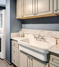 Countryhaus Vitreous China Top Mount Utility Sink With A High Backsplash.  This Sink Is Designed