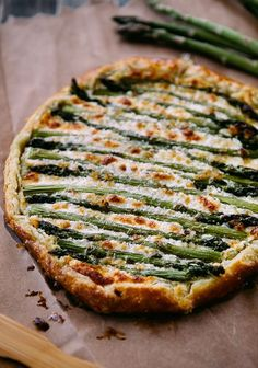 Asparagus Goat Cheese Galette. Gorgeous. I'm in an asparagus state of mind. should work with sprouted whole grain too. but keep the crust thin.
