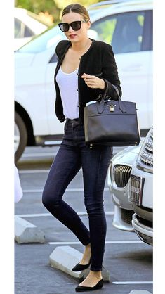 MIRANDA KERR wearing a white tee and bouclé jacket with perfectly-tailored dark wash denim and d'Orsay flats