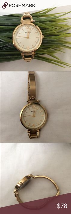 Delicate gold Fossil watch Gorgeous delicate gold Fossil watch. Hour, minute & second hands, needs a new battery! This is the perfect gold watch accessory; great for stacking! If you're looking for a dressier watch, look no further! This watch is in excellent condition, no scratches. You can adjust the band by simply removing links (unclasp), no link remover tool required!! Fossil Accessories Watches