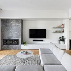A refined material palette comprised of timber and a Portsea marble fire place. Living Room Decor Fireplace, Fireplace Tv Wall, Modern Fireplace, Living Room Tv, Fireplace Design, Living Room Kitchen, Interior Design Living Room, Living Room Designs, Linear Fireplace