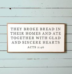 """This wall sign features the Bible verse Acts 2:46, """"They broke bread in their homes and ate together with glad and sincere hearts."""" It would make a wonderful wedding or housewarming gift and would loo"""