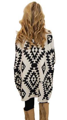 We love a great tribal print knit, leggings and fringed boots! And don't forget the big curled hair!