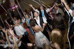 Streamer shot during dancing  Photo Credit- Kim Greer  #CincinnatiWedding #PartyPleasers #Streamershot