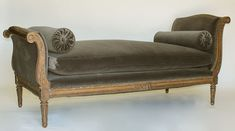A Fine and Large French 19th Century Louis XVI Style Carved Walnut Chaise Lounge (Daybed) with curved ends, floral and acanthus carving and fluted legs. Circa: Paris, 1880