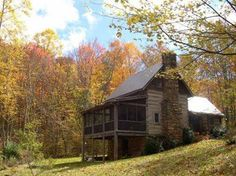 Love the look of this country home in the mountains.  Notice the screened-in porch & the ell shape of the house.