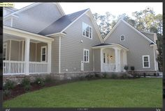 We LOVE this Southern Living style plan.   The side/garage view.  http://robertscc.com/shookhill/