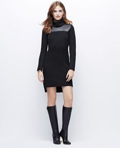 I have this. It's definitely my style but it's actually a little baggy and not quite fitted. Not my favorite sweater dress but I wear it.